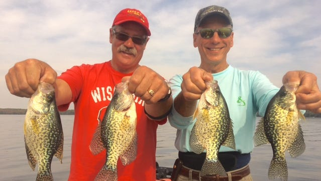 Brian Wert, left, and Kirby Krischke with four eater-sized crappies.