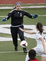 St. Georges' goalie Morgan Mitchell  makes a save in the opening round of the DIAA Division II Girls Soccer Tournament in May.