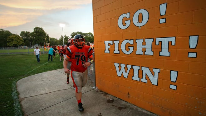 Indiana School for the Deaf lineman Trevor Howard leads the team back into the locker room during halftime against Traders Point Christian Academy, on Friday, August 22, 2014, the opening night of high school football in Indianapolis.