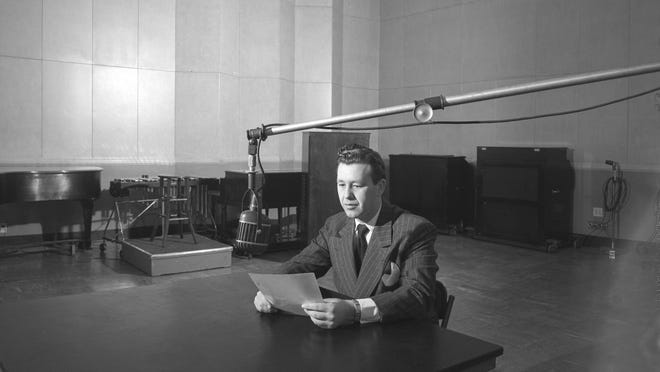 An announcer on WTMJ radio takes to the air at the station's studio at Radio City on E. Capitol Drive in this photo, likely from 1946.