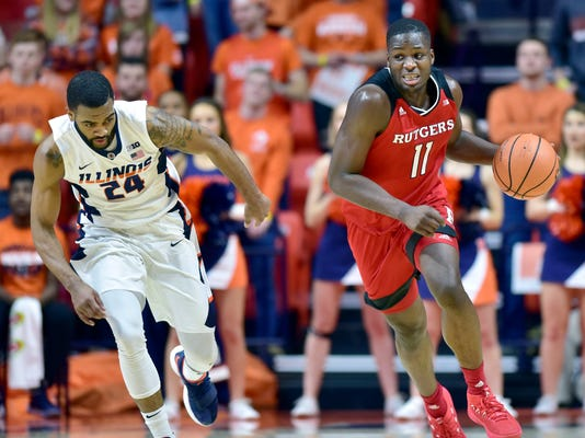 Rutgers forward Eugene Omoruyi (11) brings the ball up as Illinois guard Mark Alstork (24) follows during the first half of an NCAA college basketball game in Champaign, Ill., Tuesday, Jan. 30, 2018. (AP Photo/Stephen Haas)