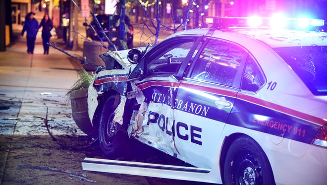 A Lebanon police car struck a concrete flower pot and tree after a collision at the intersection of 6th & Cumberland Saturday, Jan 2. The officer was taken from the scene by ambulance.