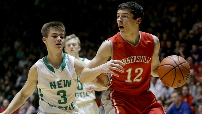 Connersville's Garrett Silcott (12) looks to drive on New Castle's Luke Bumbalough (3) in the second half of their IHSAA Sectional championship game Saturday, March 4, 2017, evening at the New Castle Chrysler High School Fieldhouse. The Connersville Spartans defeated New Castle 59-44.