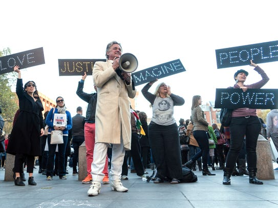 Rev. Billy Talen addresses protesters during a demonstration