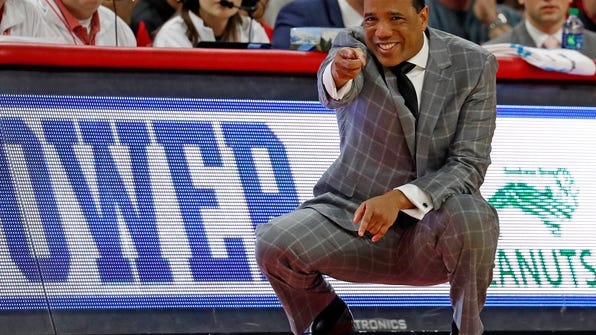FILE- In this Sunday, Jan. 21, 2018, file photo, North Carolina State head coach Kevin Keatts instructs his team from the sidelines during the first half of an NCAA college basketball game against Miami in Raleigh, N.C. Keatts' Wolfpack faces rival North Carolina on Saturday, with the Tar Heels taking 3-pointers at their highest rate under coach Roy Williams. (AP Photo/Karl B DeBlaker, File)