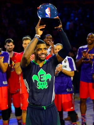 Kyrie Irving hoists the All-Star MVP trophy after the Eastern Conference's comeback win Sunday.