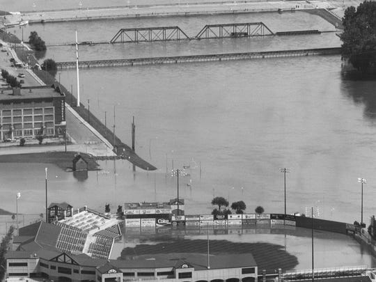 It didn't rain Sunday, July 11, 1993, but it was still much too wet to play anything but water polo at Sec Taylor Stadium in Des Moines. And judging by the fact that the Des Moines River is playing left, right and centerfield, the park probably won't be fit for the Iowa Cubs for a while.