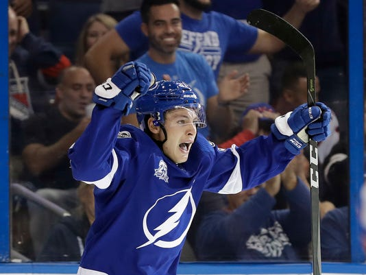 Tampa Bay Lightning center Yanni Gourde celebrates his goal against the New York Rangers during the second period of an NHL hockey game Thursday, Nov. 2, 2017, in Tampa, Fla. (AP Photo/Chris O'Meara)