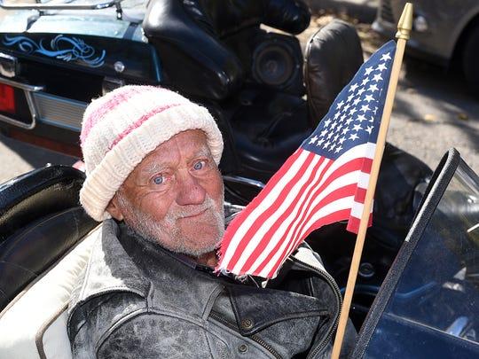 World War II veteran Gene Hadden, 91, waits in a motorcycle
