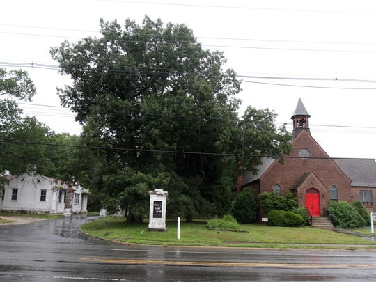 The Forked River Presbyterian Church (right) is trying to take over the abandoned game farm gatehouse (left) owned by the state.