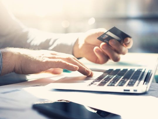 paying-with-credit-card-online_gettyimages-514568144_large.jpg