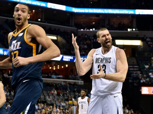 Memphis Grizzlies center Marc Gasol (33) and Utah Jazz center Rudy Gobert (27) react to a call during the first half of an NBA basketball game Wednesday, Feb. 7, 2018, in Memphis, Tenn. (AP Photo/Brandon Dill)