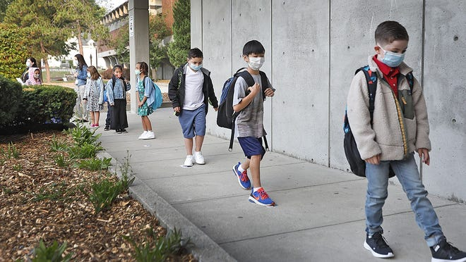 The first day of classes in person at the Lincoln-Hancock School in Quincy went off just like any other year, but with added covid masks on Thursday September 17, 2020  Greg Derr/ The Patriot Ledger