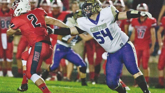 Canton lineman Micah Barnhart looks to make a tackle during a game against Pekin in 2018 at Memorial Stadium.