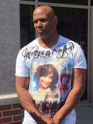 Ronald Williams wears a t-shirt with his daughter's