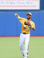 Angelo State's Jacob Boston warms up betweening innings