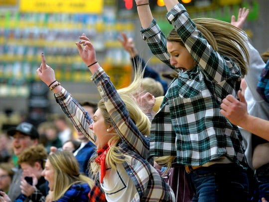 Great Falls High fans cheer on their team during recent