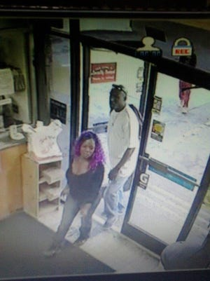 The Jackson Police Department seeks these two suspects after a wallet went missing from a Citgo counter.