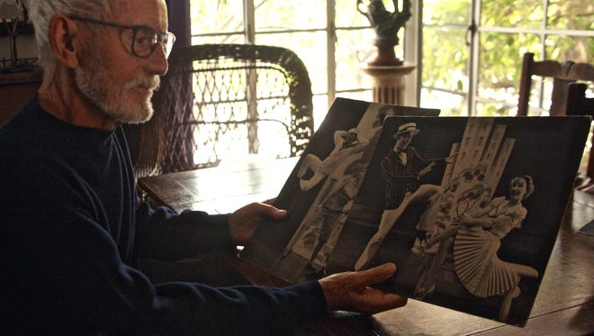 Geoffrey Webb, 86, looks at photographs and reminisces his earlier years as a stage and television actor at his Palm Springs home on Wednesday, Dec. 9, 2015. Due to Parkinson's disease, Webb has suffered loss of control over movement as well as flexibility and is no longer able to dance.