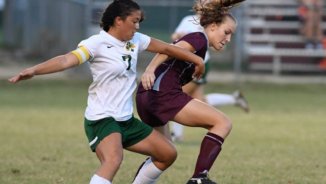 University Heights' Alli Cundiff (left) and Henderson's Maddie Griggs play as the Henderson County Lady Colonels play University Heights in the Second Region Girls Soccer Tournament semi-final at Colonel Field Wednesday, October 19, 2016.