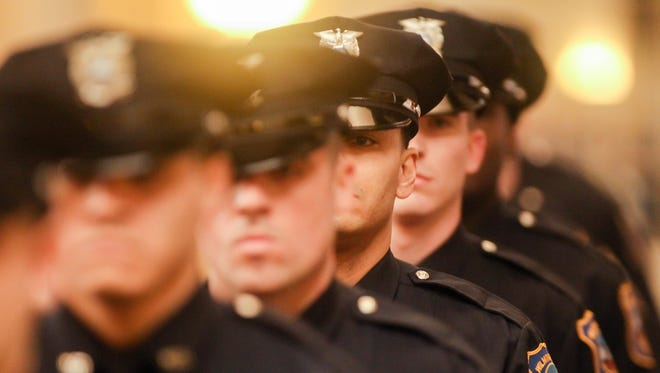 Members of the 97th Wilmington Police Academy graduating class march into the Chase Center on the Riverfront ballroom on Thursday, Feb. 10, 2017, in Wilmington.
