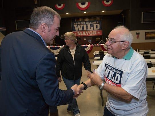 Mayor William Wild speaks with supporter Regis Miller.