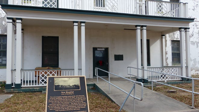 The entrance to the old hospital at Fort Stanton is marked by an informational sign.