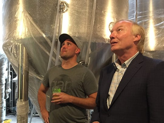 J.T. Merryweather, left, of RaR Brewing gives Maryland