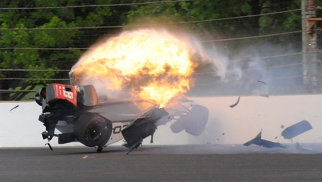The car driven by Sebastien Bourdais hits the wall and bursts into flames in the second turn during qualifications for the Indianapolis 500 on Saturday.