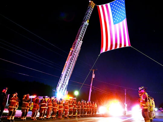 First responders and community members pay respects