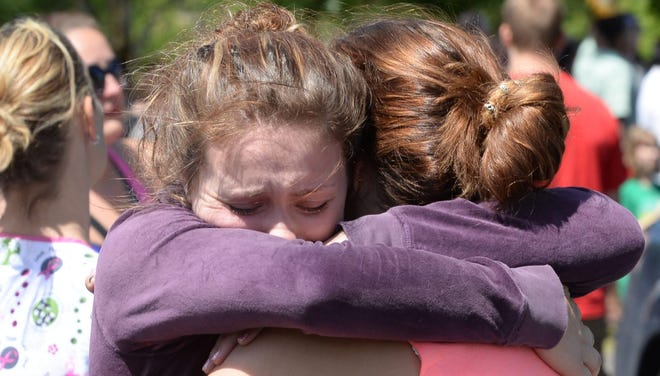 Students are reunited with their parents after police responded to an Oregon school shooting.