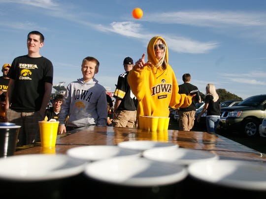 UI senior Allison Gill, of Iowa City, throws the ball in a game of beer pong while tailgating before the Outback Bowl, Jan. 1, 2009, in Tampa, Fla.