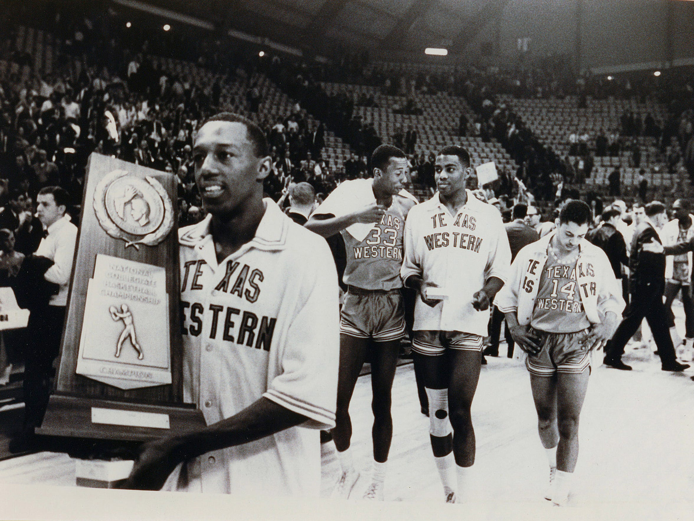 Members of the 1966 NCAA Championship team walk off
