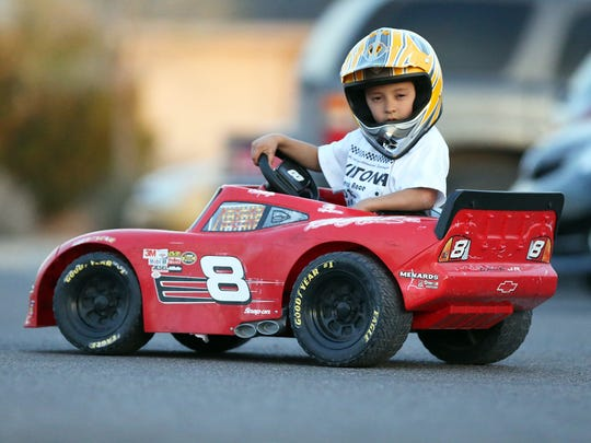 Alan Dominguez loves driving his Power Wheels Dale Earnhardt Jr. replica car. He hopes to one day compete in NASCAR and the Daytona 500.