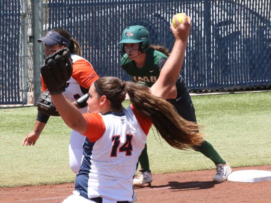UTEP right hander Kaitlin Fifield, 14, lets a pitch