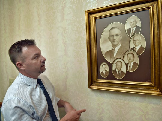 Tommy  Geisel, Geisel Funeral Home, 333 Falling Spring Rd., Chambersburg, looks at photographs of relatives who ran the business.  The business has been in the family for generations.