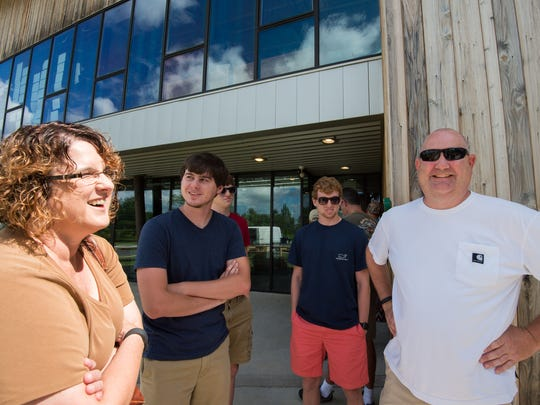 Melissa O'Toole, left of Harrisburg, Pa., and her husband Joe and their family wait in line for Dogfish Head Brewery in Milton to open for tours and tasting.