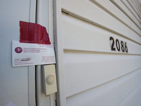 Capt. Reed Jones with the Delaware Office of Animal Welfare left his business card on Anthony Appolonia's door at his town house in Dover.