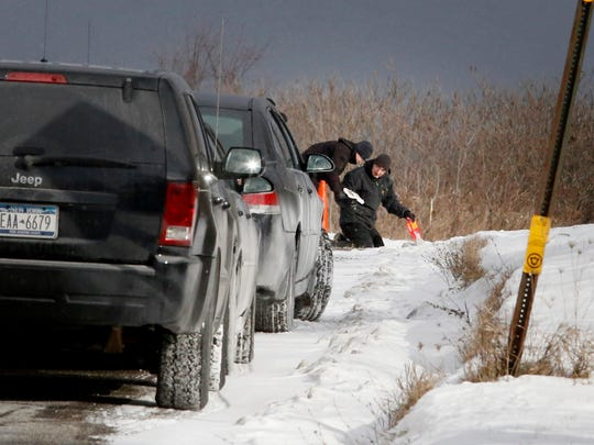 Law enforcement officials search the eastern side of Draht Hill Road near the Jerusalem Hill Road intersection in the Town of Elmira on Dec. 15. Robyn Roper, a 33-year-old from the Bronx, was found dead on the side of the road Dec. 14. She had multiple gunshot wounds.