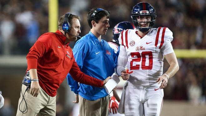 Hugh Freeze, left, opted to start Shea Patterson (20) against Texas A&M and burn the freshman's redshirt on Saturday.