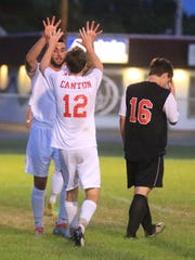 Celebrating one of Canton's five goals Tuesday are