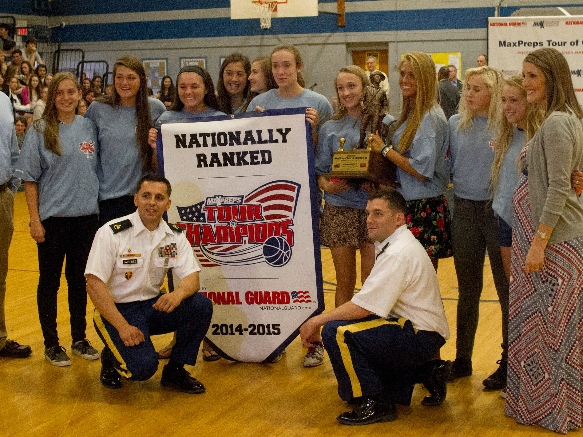 NJSIAA Tournament of Champion winners Manasquan High School Girls Basketball poses with trophy and Army National Guard Staff Sargeants Angelo Martinez and Anthony Larobina. Photo taken at Manasquan High School in Manasquan NJ on May 15, 2015.