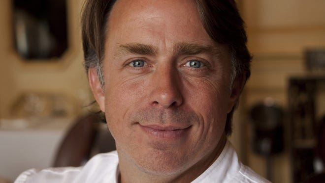 Chef John Besh poses in one of his New Orleans restaurants.