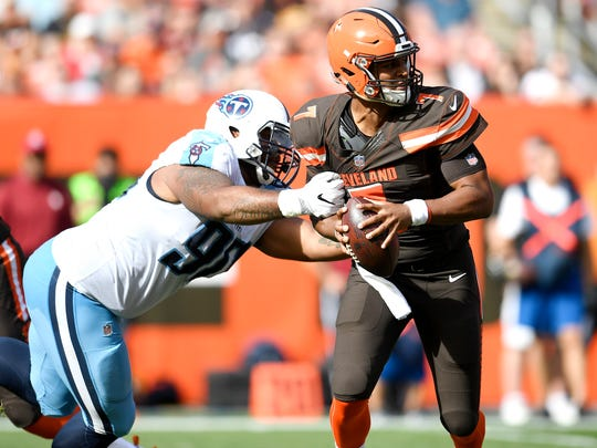 Titans defensive end DaQuan Jones (90) pressures Browns quarterback DeShone Kizer (7) during the second quarter at FirstEnergy Stadium Sunday, Oct. 22, 2017 in Cleveland, Ohio.