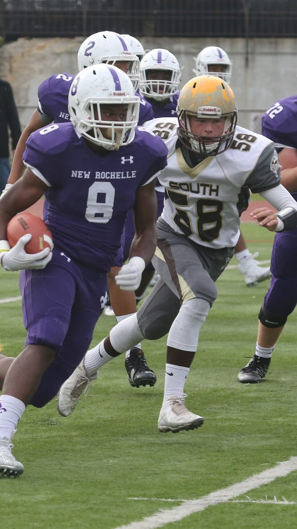 New Rochelle's Jordan Forrest carries the ball as Clarkstown