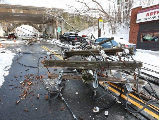 Utility poles fell like dominoes along Lockwood Avenue