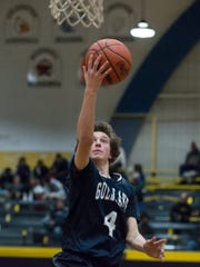 Gull Lake's Dominik Mastromatteo (4) goes for two points.