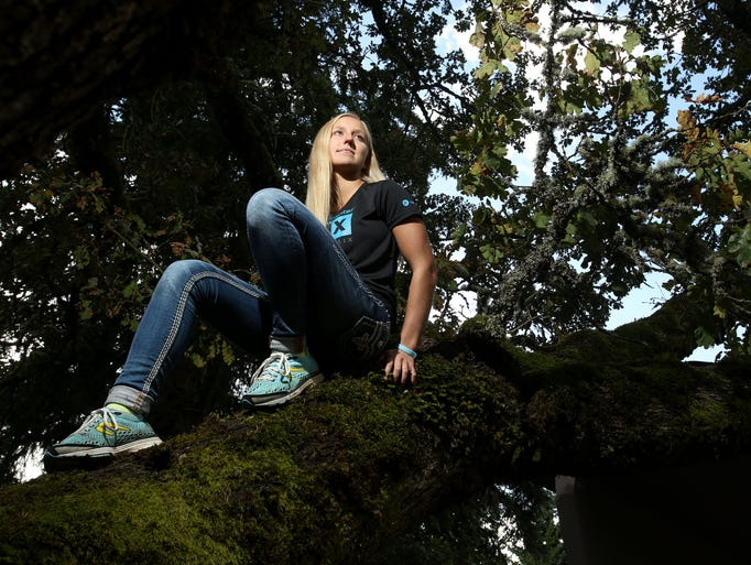 Super-athlete Winter Vinecki poses for photos at her