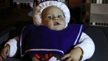 "Trey WIble, 11 1/2 months, Little Egg Harbor, fills in for the Stay Puff Marshmallow Man on this ""Ghostbusters"" themed float in the Toms River Halloween Parade Saturday night."