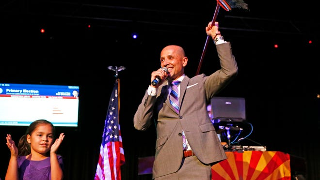 David Garcia, Democratic candidate for Arizona superintendent of public instruction, brings out the broom on primary-election night.